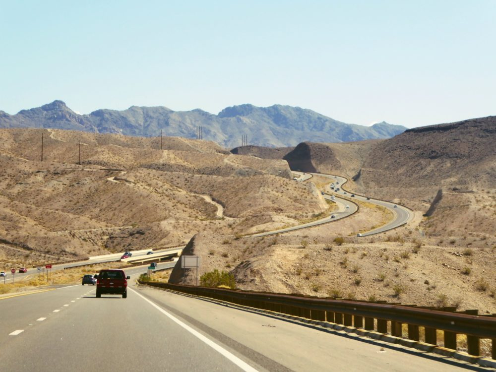 The drive from Las Vegas to the Grand Canyon South Rim by car passes through the Arizona/Nevada landscape near the Hoover Dam.