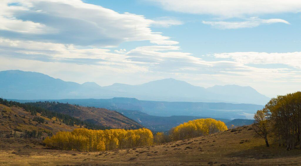 Mountain vista with yellow aspens in the foreground