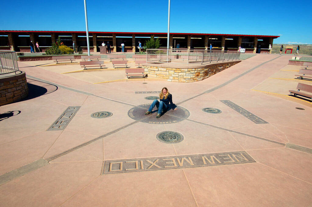 sitting on the Four Corners monument